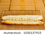 Small photo of Food scarcity word on baguette