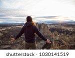 man enjoying the beautiful... | Shutterstock . vector #1030141519