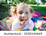 excited face of pretty small... | Shutterstock . vector #1030144669