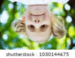 excited face of pretty small... | Shutterstock . vector #1030144675