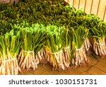 huge piles of calcots prepared...   Shutterstock . vector #1030151731