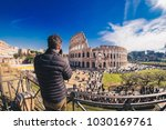 tourist taking pictures at the... | Shutterstock . vector #1030169761