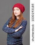 a girl in a red woolen hat and... | Shutterstock . vector #1030193185