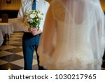 bride and groom with a bouquet... | Shutterstock . vector #1030217965