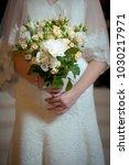 bride with wedding bouquet in... | Shutterstock . vector #1030217971