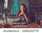 young fashion designer sitting... | Shutterstock . vector #1030232779