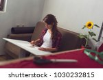 young fashion designer making a ... | Shutterstock . vector #1030232815