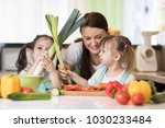 mom and kids daughters have a... | Shutterstock . vector #1030233484