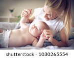 playing with mine baby boy...   Shutterstock . vector #1030265554