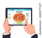 choosing pizza on tablet... | Shutterstock .eps vector #1030277137