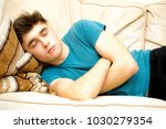 student taking a nap on a sofa | Shutterstock . vector #1030279354