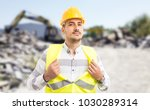 Professional worker acting like a superhero showing chest as powerful and successful construction builder concept - stock photo