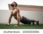 relaxed handsome man doing yoga ... | Shutterstock . vector #1030303081