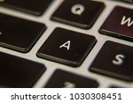 a keyboard key button press... | Shutterstock . vector #1030308451