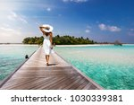 attractive woman in white walks ... | Shutterstock . vector #1030339381