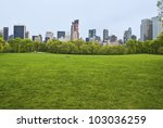 """""""Spring View Sheep Meadow"""" The huge lawn of Sheep Meadow in Central Park on a quiet Spring Day in Manhattan. - stock photo"""