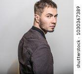 handsome man pose in studio.   Shutterstock . vector #1030367389