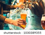 hand of bartender pouring a... | Shutterstock . vector #1030389355
