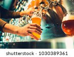 hand of bartender pouring a... | Shutterstock . vector #1030389361