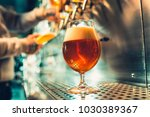 hand of bartender pouring a... | Shutterstock . vector #1030389367