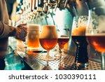 we meet oktoberfest. hand of... | Shutterstock . vector #1030390111