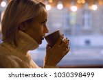 young woman in a knited sweater ... | Shutterstock . vector #1030398499