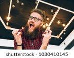 portrait of cute hipster... | Shutterstock . vector #1030410145