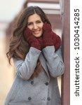 beautiful woman in grey coat...   Shutterstock . vector #1030414285