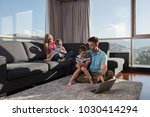 happy family. father  mother... | Shutterstock . vector #1030414294