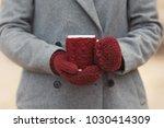 closeup hands in knitted gloves ...   Shutterstock . vector #1030414309