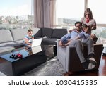 happy couple spending time with ... | Shutterstock . vector #1030415335