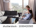 young couple relaxing at  home... | Shutterstock . vector #1030420585