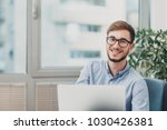 young intern working at the... | Shutterstock . vector #1030426381