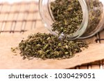 handful of green tea leaves on... | Shutterstock . vector #1030429051