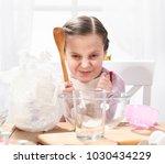 portrait of girl in kitchen...   Shutterstock . vector #1030434229