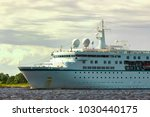 white cruise liner in riga city....   Shutterstock . vector #1030440175
