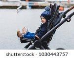 baby sitting in a pram   buggy...   Shutterstock . vector #1030443757