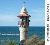 minaret of al bahr mosque and... | Shutterstock . vector #1030451461