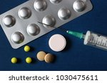 tablets and syringe close up | Shutterstock . vector #1030475611