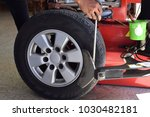 worker use tire changer... | Shutterstock . vector #1030482181