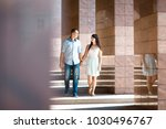 young couple admire each other... | Shutterstock . vector #1030496767