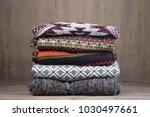 pile of knitted winter sweaters ... | Shutterstock . vector #1030497661