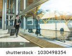 young businessman walking at... | Shutterstock . vector #1030498354