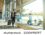 young businessman walking at... | Shutterstock . vector #1030498597