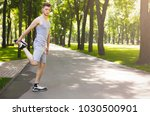 fitness man stretching his legs ... | Shutterstock . vector #1030500901