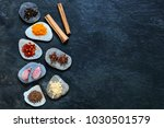 colorful spices on pebbles with ... | Shutterstock . vector #1030501579