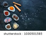 colorful spices on pebbles with ... | Shutterstock . vector #1030501585