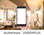 man hand holding blank screen...   Shutterstock . vector #1030549114