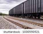 rail freight cars on rails | Shutterstock . vector #1030550521