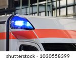blue lights on an ambulance | Shutterstock . vector #1030558399